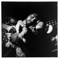 Bruce Cratsley (American, 1944-1998). Resting with Animals (Lover with AIDS), 1991. Toned gelatin silver photograph, image/sheet: 9 1/2 x 9 1/2 in. (24.1 x 24.1 cm). Brooklyn Museum, Gift of Mr. and Mrs. Gilbert Millstein, 1993.169.4. © artist or artist's estate