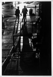Orville Robertson (American, born 1957). Running Lovers, White Street and Avenue of the Americas, Manhatten, 1986, printed 1994. Gelatin silver photograph, sheet: 13 15/16 x 10 7/8 in. Brooklyn Museum, Purchased with funds given by the Horace W. Goldsmith Foundation, Harry Kahn, and Mrs. Carl L. Selden, 1994.130. © artist or artist's estate