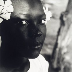 Tony Gleaton (American, born 1948). Black Girl, White Flower, Belize, Central America, 1992. Gelatin silver photograph, Image: 15 3/4 x 14 3/4 in. (40 x 37.5 cm). Brooklyn Museum, Gift of Helen Griffith in memory of Seymour Griffith, 1997.134. © Tony Gleaton