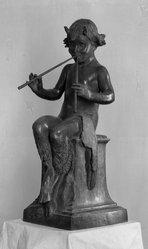 Janet Scudder (American, 1873-1940). Seated Faun, 1924. Bronze, 38 x 14 3/8 x 18 1/4 in. (96.5 x 36.5 x 46.4 cm). Brooklyn Museum, Robert B. Woodward Memorial Fund, 26.184. © artist or artist's estate