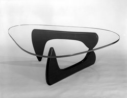 Isamu Noguchi (American, 1904-1988). Lounge Table, Designed 1944; Manufactured 1945. Glass, walnut, Overall: 15 3/4 x 50 x 36 in.  (40.0 x 127.0 x 91.4 cm);. Brooklyn Museum, Gift of Mr. and Mrs. H. Lawrence Herring, 76.96a-c. © artist or artist's estate