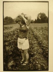 Rosalie Winard. Jessy Park with Her Arms Raised in a Vegetable Garden, Williamstown, MA, from the Born Electrical Series, 1996. Gelatin silver photograph, image: 7 7/8 x 11 1/2 in. (19.9 x 29.3 cm). Brooklyn Museum, Gift of Mary McClean, 1997.98.4. © artist or artist's estate