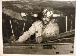 Builder Levy (American, born 1942). Dave Moore Working on the Longwall Keystone #5 Mine, Eastern Associated Coal Co., Affinity, W. Va., 1982. Toned gelatin silver photograph Brooklyn Museum, Gift of Harold and Vivian Levy, 85.189.3. © artist or artist's estate