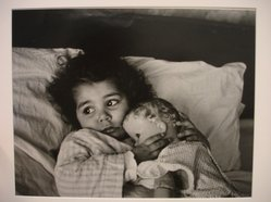 W. Eugene Smith (American, 1918-1978). [Untitled] (Juanita Lying in Bed Hugging Doll), n.d. Gelatin silver photograph, Sheet: 9 3/4 x 11 5/16 in. (24.8 x 28.8 cm). Brooklyn Museum, Gift of Philip Goutell, 87.245.13. © W. Eugene Smith