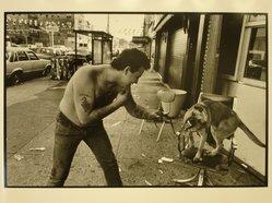 Ethel Wolvovitz (American, born 1946). Boy Vs. Dog, 1986. Gelatin silver photograph, Sheet: 11 x 14 in.  (27.9 x 35.6 cm). Brooklyn Museum, Gift of the artist, 87.52.3. © artist or artist's estate